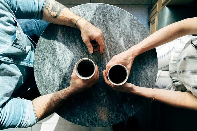 couple-talking-over-coffee